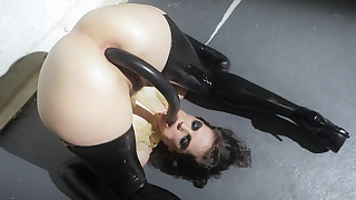 Bobbi Starr in leather inserting various toys in her anus
