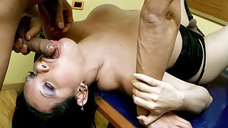 Dark haired tranny slut shows off her cock handling skills!